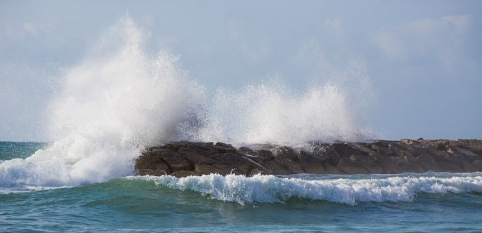 Waves crashing on breakwater